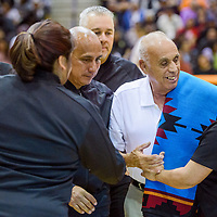 Joe Vargas is greeted and honored by his fellow referees during an award ceremony at Gallup High School Thursday.