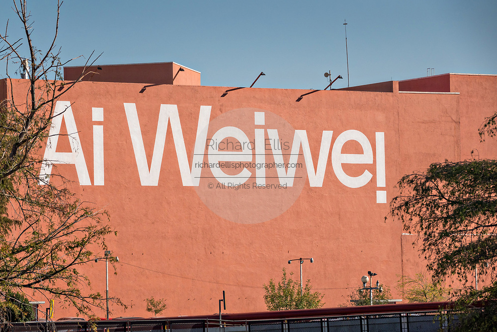 Sign painted on the side of the Museum of Contemporary Art or Museo de Arte Contemporaneo advertising the Chinese artist Ai Weiwei exhibition adjacent to the Macroplaza Grand Plaza in the Barrio Antiguo neighborhood of Monterrey, Nuevo Leon, Mexico.