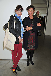 Left to right, JASMINE GUINNESS and VIVIENNE GUINNESS at the ASAP (African Solutions to African Problems) Lunch held at the Louise T Blouin Foundation, 3 Olaf Street, London W11 on 15th May 2012.