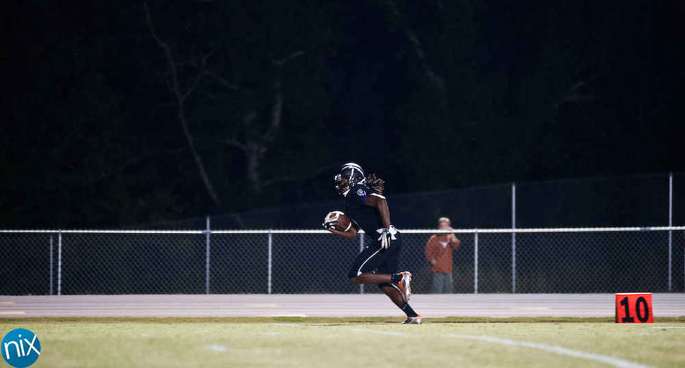 Cox Mill's Ryan Hill makes his way to the end zone for a score against Hickory Ridge Friday night at Cox Mill High School. Hickory Ridge won the game 21-19. (Photo by James Nix)