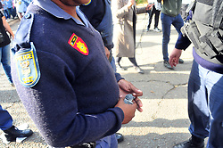 JOHANNESBURG, SOUTH AFRICA – APRIL 07: Police set off stun grenades to disperse a small group of pro Zuma member from Black Land First (BLF) and anti Zuma protestors gathered outside the Gupta's Saxonwold residence call for President Zuma to step down, the Guptas through their businesses are accused of links to goverment officials and the president, in Johannesburg, South Africa, 07 April 2017. Businesses closed and South Africans from numerous political, religious, labour and civic groups gathered at central points across the entire country protesting against President Zuma's recent government reshuffle appointing 10 new ministers and 10 new deputy ministers including the axing of the finance minister. Photo: Dino Lloyd