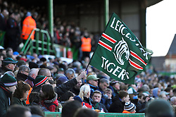 A Leicester Tigers fan in the crowd waves a flag in support - Photo mandatory by-line: Patrick Khachfe/JMP - Tel: Mobile: 07966 386802 23/03/2014 - SPORT - RUGBY UNION - Welford Road, Leicester - Leicester Tigers v Exeter Chiefs - Aviva Premiership.