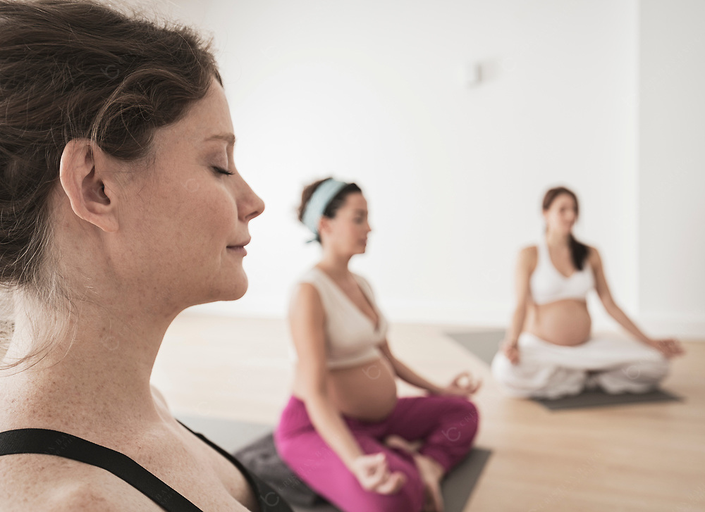 Group of pregnant woman in yoga class