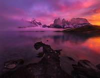 A dramatic sunrise over the mountains as seen from Lago Pehoe in Torres del Paine National Park, Chile