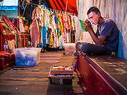 18 JANUARY 2015 - BANGKOK, THAILAND:  A performer with the Sai Yong Hong Opera Troupe puts on his make up before performing at the Chaomae Thapthim Shrine, a Chinese shrine in a working class neighborhood of Bangkok near the Chulalongkorn University campus. The troupe's nine night performance at the shrine is an annual tradition and is the start of the Lunar New Year celebrations in the neighborhood. The performance is the shrine's way of thanking the Gods for making the year that is ending a successful one. Lunar New Year, also called Chinese New Year, is officially February 19 this year. Teochew opera is a form of Chinese opera that is popular in Thailand and Malaysia.             PHOTO BY JACK KURTZ
