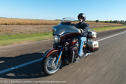 Lonnie Entenman of J&L Harley-Davidson and member of Sioux Falls HOG on his  2011 FLHXSE for the USS South Dakota submarine flag relay across South Dakota on the first day from Sturgis to Aberdeen. SD. USA. Saturday October 7, 2017. Photography ©2017 Michael Lichter.