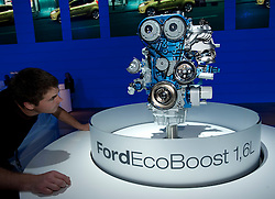Man examines new efficient Eco Boost engine frrom Ford at the Frankfurt Motor Show 2009