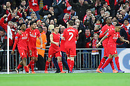 Philippe Coutinho of Liverpool (c)celebrates with his teammates after scoring his teams 1st goal. Capital One Cup Final, Liverpool v Manchester City at Wembley stadium in London, England on Sunday 28th Feb 2016. pic by Chris Stading, Andrew Orchard sports photography.