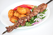 Char grilled Beef Shish Kebab Skewer with baked potatoes