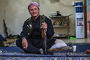 A young member of the Free Syrian Army (FSA) take a moment to smoke a cogarette as he holds his kallashnikov AK47 rifle ahead of a military operation in Minaq (Menagh) military airport on Friday, Jun 29, 2012. (Photo by Vudi Xhymshiti)