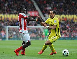 Stoke City's Mame Biram Diouf attempts to pass Tottenham Hotspur's Nacer Chadli - Photo mandatory by-line: Dougie Allward/JMP - Mobile: 07966 386802 - 09/05/2015 - SPORT - Football - Stoke - Britannia Stadium<br />  - Stoke v Tottenham Hotspur - Barclays Premier League