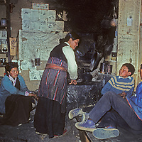 Ang Lakpa Sherpani talks with her children in their kitchen in Namche Bazaar, the leading Sherpa town in Nepal's Himalaya.  (Her husband, Kancha Sherpa, was a famous trekking guide at the time [1980].)