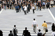 people starting to cross the Hachiko square zebra crossing Tokyo Japan