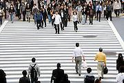 people starting to cross the Hachiko square zebra crossing Tokyo Japan