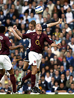 Photo: Chris Ratcliffe.<br />Tottenham Hotspur v Arsenal. The Barclays Premiership.<br />29/10/2005.<br />Michael Dawson of Spurs and Dennis Bergkamp of Arsenal challenge for an aerial ball