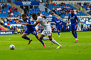 Bournemouth forward Jaidon Anthony  (32) under pressure from Cardiff City midfielder Tom Sang  (28) during the EFL Sky Bet Championship match between Cardiff City and Bournemouth at the Cardiff City Stadium, Cardiff, Wales on 18 September 2021.