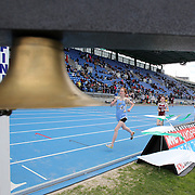 A official sounds the bell for the last lap during competition at the 2013 NYC Mayor's Cup Outdoor Track and Field Championships at Icahn Stadium, Randall's Island, New York USA.13th April 2013 Photo Tim Clayton