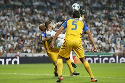 (L-R) Carlao of APOEL FC, Sergio Ramos of Real Madrid, Jesus Rueda of APOEL FC 3-0 during the UEFA Champions League group H match between Real Madrid and APOEL FC on September 13, 2017 at the Santiago Bernabeu stadium in Madrid, Spain.
