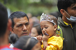 August 14, 2017 - Kathmandu, NP, Nepal - A Father carrying his son impersonate as Lord Krishna during Krishna Janmashtami Festival celebrated at ISKON Nepal, Budhanilkantha, Kathmandu, Nepal on Monday, August 14, 2017. Krishna Janmashtami festival marks the birthday of Hindu God Krishna, the eight incarnation of Lord Vishnu. (Credit Image: © Narayan Maharjan/Pacific Press via ZUMA Wire)