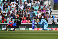 Cricket - 2019 ICC Cricket World Cup warm-ups - England vs. Afghanistan <br /> <br /> Afghanistan's Gulbadin Naib run out by England's Liam Plunkett and Moeen Ali, at The Oval.<br /> <br /> COLORSPORT/ASHLEY WESTERN