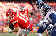 Kansas City Chiefs quarterback Patrick Mahomes (15) regains control of the ball as he scrambles for a touchdown during an NFL, AFC Championship football game Sunday, Jan. 19, 2020, in Kansas City, MO. The Chiefs won 35-24 to advance to Super Bowl 54. Photo/Colin E. Braley Colin Eric Braley Photography