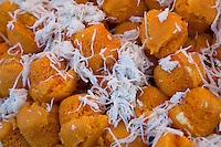 Khanom Wan, steamed pumpkin cakes topped with coconut, a favorite Thai sweet treat.
