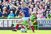 Forest Green Rovers Isaac Pearce(17) is bundled over by Exeter City midfielder Jake Taylor (25) during the EFL Sky Bet League 2 match between Forest Green Rovers and Exeter City at the New Lawn, Forest Green, United Kingdom on 4 May 2019.