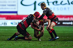 Scarlets' Ioan Nicholas is tackled by Dragons' Joseph Davies and Dragons' Sarel Pretorius<br /> <br /> Photographer Craig Thomas/Replay Images<br /> <br /> Guinness PRO14 Round 13 - Scarlets v Dragons - Friday 5th January 2018 - Parc Y Scarlets - Llanelli<br /> <br /> World Copyright © Replay Images . All rights reserved. info@replayimages.co.uk - http://replayimages.co.uk