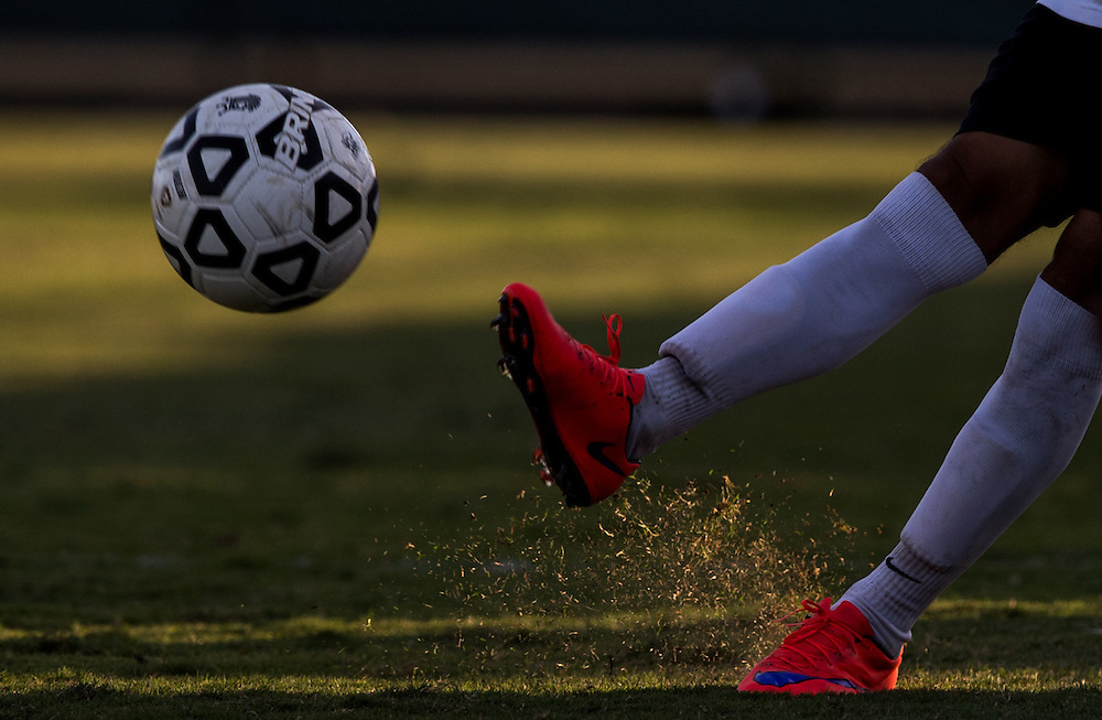 A player of Golden West College kicking the ball from the sideline during a soccer game on November 4, 2016, at Fullerton College, in Fullerton, California. Golden West won 2-0 against Fullerton College.