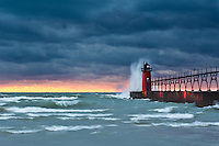 The setting sun, low clouds and waves crashing against South Haven's lighthouse all lend a hand in the moody feel to this image.