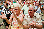 Aug, 25, 2009 -- SUN CITY, AZ: LIL SCHARENBRACH and her husband ROGER SCHARENBRACH cheer for Sen. John McCain during the Town Hall meeting on health care sponsored by Sen McCain at Grace Bible Church in Sun City, AZ, Tuesday. More than 1,000 people attended the meeting in the church, which seats 700. Sun City is a staunchly Republican suburb of Phoenix and most of the crowd was opposed to President Obama health care reform efforts.    Photo by Jack Kurtz