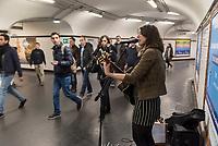 Carole Geoffroy, a 31-year-old singer, sings at  Denfert-Rochereau RER station.