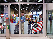 28 JULY 2007 -- ZURICH, SWITZERLAND: People with an American flag in the airport in Zurich. PHOTO BY JACK KURTZ