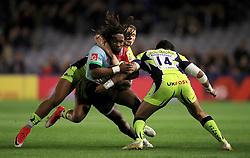 Harlequins' Marland Yarde (centre) is tacked by Sale Sharks' Denny Solomonia during the Aviva Premiership match at Twickenham Stoop, London.
