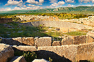 Mycenae Grave Circle A. A 16th century BC royal cemetery containing six shaft graves, where a total of nineteen bodies were buried among the objects found were a series of gold death masks including Agamemnons. Excavated by the archaeologist Heinrich Schliemann in 1876, following the descriptions of Homer and Pausanias.  Mycenae UNESCO World Heritage  Archaeological Site, Peloponnese, Greece . <br /> <br /> Visit our MYCENAEN ART PHOTO COLLECTIONS for more photos to download  as wall art prints https://funkystock.photoshelter.com/gallery-collection/Pictures-Images-of-Ancient-Mycenaean-Art-Artefacts-Archaeology-Sites/C0000xRC5WLQcbhQ<br /> .<br /> <br /> Visit our GREEK HISTORIC PLACES PHOTO COLLECTIONS for more photos to download or buy as wall art prints https://funkystock.photoshelter.com/gallery-collection/Pictures-Images-of-Greece-Photos-of-Greek-Historic-Landmark-Sites/C0000w6e8OkknEb8