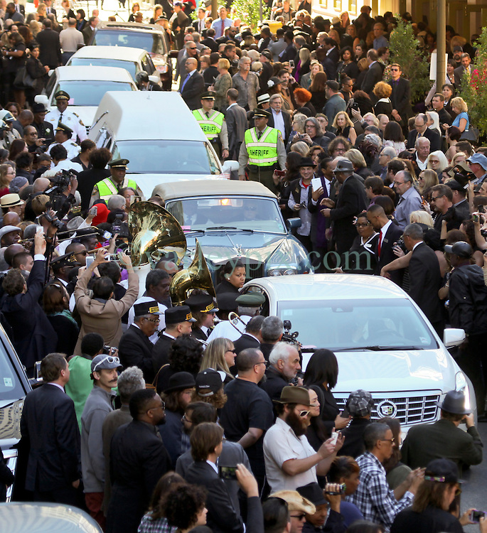 20 November 2015. Orpheum Theater, New Orleans, Louisiana. <br /> Memorial service for musician Allen Toussaint. The service spills out of the Orpheum Theater in a second line procession following the touching memorial service for one of the city's most influential musicians. <br /> Photo; Charlie Varley/varleypix.com