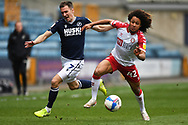 Millwall Midfielder Jed Wallace(7)  and Bristol City Midfielder Han-Noah Massengo (42)  battles for possession during the EFL Sky Bet Championship match between Millwall and Bristol City at The Den, London, England on 1 May 2021.