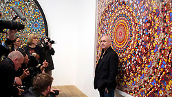 © Licensed to London News Pictures. 02/04/2012. London, UK . Damien Hirst is photographed as he stands in front of I Am Become Death, Shatterer of Worlds 2006. The Tate Modern presents the first substantial retrospective of British artist Damien Hirst. The exhibition tuns 4th April - 9th September at Tate Modern London. Photographers Stephen Simpson/LNP