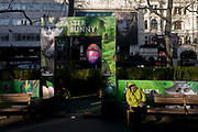 "An incongruous fantasy landscape has been installed in London's Leicester Square where movie premiers at various cinemas atrract interest from the young and old, in this case, film theme characters' faces from ""Rise of the Guardians"" by the DreamWorks. The production is a 2012 3D computer-animated fantasy-adventure film based on William Joyce's The Guardians of Childhood book series and The Man in the Moon short film by Joyce and Reel FX. In the background is the stark young face of Cosette, a character in Les Miserables."
