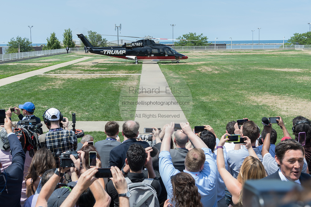 GOP Presidential nominee Donald Trump arrives by private helicopter welcomed by hundreds of media, Vice Presidential nominee Indiana Governor Mike Pence and his children as he arrives for the Republican National Convention July 20, 2016 in Cleveland, Ohio. Trump flew into the lakeside airport by his private jet and then by helicopter for a grand arrival.