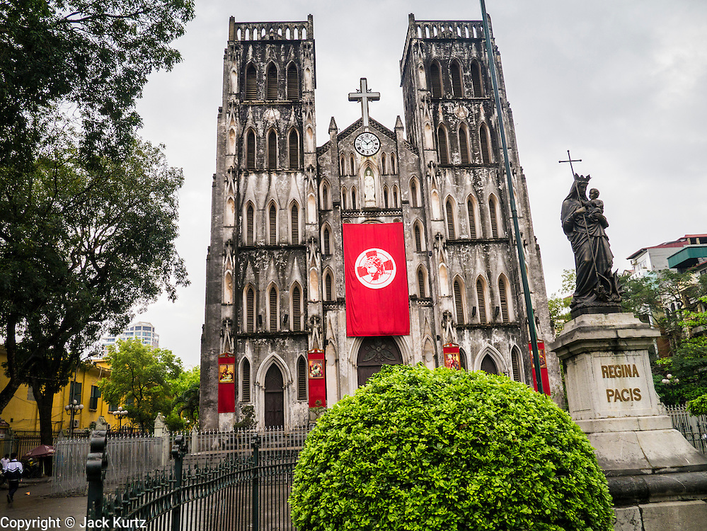 07 APRIL 2012 - HANOI, VIETNAM: St. Joseph's Roman Catholic Cathedral in Hanoi, the capital of Vietnam. (In Vietnamese: Nhà th Ln Hà Ni, Nhà th Chính tòa Thánh Giuse) It is the seat of the Roman Catholic Archdiocese of Hanoi. The church was built in 1886 in the neo-gothic style. Hanoi is one of the oldest cities in Southeast Asia. It was established in 1010 A.D.   PHOTO BY JACK KURTZ
