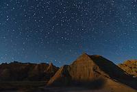 Moonlight illuminates the top of the badlands in South Dakota.