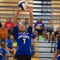 090914     Cayla Nimmo<br /> <br /> Laguna Acoma Lady Hawk Alysha Barney (7) taps the ball during the game against the Patriots at Miyamura High School Tuesday night.