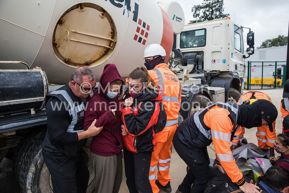 Security guards working on behalf of HS2 remove environmental activists from HS2 Rebellion from the road in front of a gate providing access to a site for the HS2 high-speed rail link on 12 September 2020 in Harefield, United Kingdom. Anti-HS2 activists continue to try to prevent or delay works on the controversial £106bn HS2 high-speed rail link in the Colne Valley where thousands of trees have already been felled.