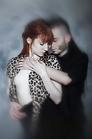 cute young caucasian couple urban style loving each other on isolated background