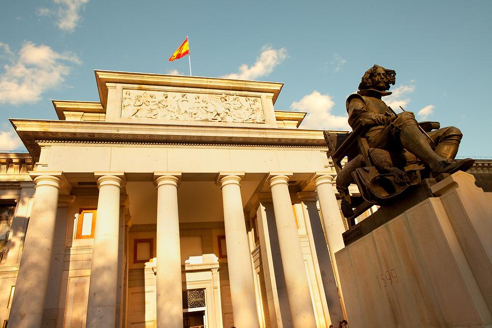 Madrid, Spain - Detail od the facade of Museo del Prado (Prado art Museum) and painter Velazquez statue.