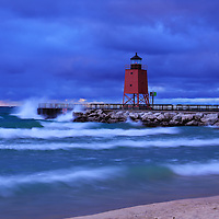 """""""Waves Upon Charlevoix""""<br /> <br /> Scenic long exposure at the beautiful red lighthouse in Charlevoix Michigan during a storm at sunset!!<br /> <br /> Lighthouses of the Great Lakes by Rachel Cohen"""