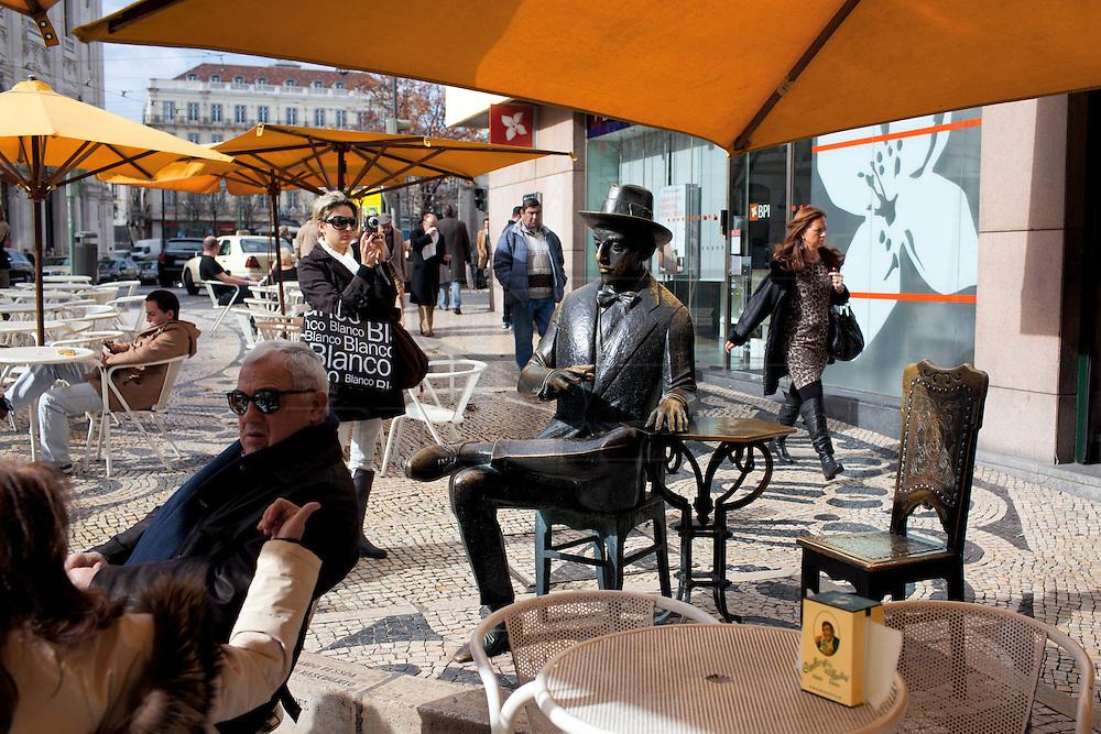 A bronze statue of one of the most famous portuguese poets, Fernando Pessoa, outside his favorite café Pastelaria A Brasileira at Rua Garrett, in the Chiado district.