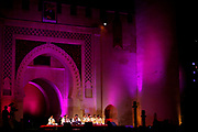 The Bab Makina in Fes, Morocco is the main venue for musical evenings at the annual Fes Festival of World Sacred Music that takes place every June. This particuar evening's featured music from the city of Lahore, Pakistan, was performed by the official patron saint, Akhtar Sharif Arup Vale Qawwals and his group of uplifting singers on Tuesday evening, June 04, 2007. (PHOTO BY TIMOTHY D. BURDICK)