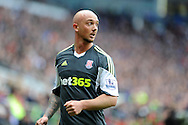Stephen Ireland of Stoke city looks on. Barclays Premier league match, Cardiff city  v Stoke city at the Cardiff city stadium in Cardiff, South Wales on Saturday 19th April 2014. pic by Andrew Orchard, Andrew Orchard sports photography,